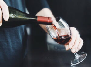 Wine Maven | the man pours red wine in a glass t20 yRaVea